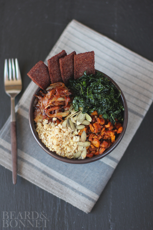 This delicious Fall Harvest Bowl is made with chili spiced butternut squash paired with caramelized onions, massaged kale, pepitas, and millet and Massel gluten-free bouillon. Image from www.beardandbonnet.com