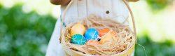Little girl and easter egg basket
