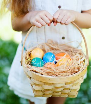 Little girl and easter egg basket